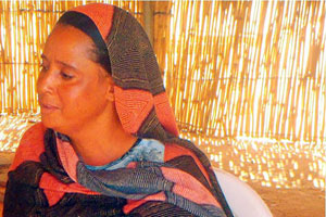 Matala Wallete with her red djellaba is well known in the camp.