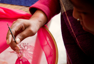 Women earn money by embroidering cloth and doing other tasks at Karuna Bhawan. Credit: Sheahen/Caritas