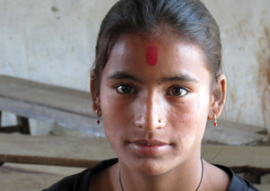 Sushila, a teenage girl in western Nepal, has a minor physical disability and is not treated well by her stepmother. Caritas pays her school fees so that her family will keep her in school. Girls who drop out are more vulnerable to sex traffickers.  Credit: Laura Sheahen/Caritas