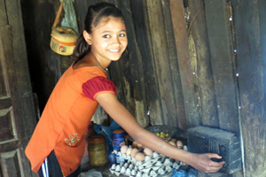 "Thirteen-year-old Sweta is an orphan being raised by relatives. Caritas Nepal pays for her to go to school. When she and her school friends listen to the radio, they hear a Caritas radio ""jingle"" warning them about trafficking. Credit: Laura Sheahen/Caritas"