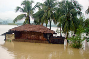 A house submerged in water in Satkania, Bangladesh Credits: Caritas
