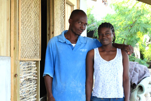 A couple in front of their new house built with the support of Caritas Austria. Credits: Caritas