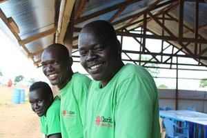 Caritas volunteers at a transit camp for people returning to South Sudan from Sudan. Here, Caritas works with the International Organization for Migration (IOM) and other groups to help families who are about to start a new life in the newly-created country. With funding from Caritas members worldwide, Caritas Juba has mobilized volunteers to construct IOM tents, distribute items like mosquito nets, and provide hygiene training to camp residents. Credits: Sheahen/Caritas