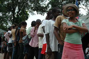 Children queuing for food at St. Marie Credits: Magnier/Caritas