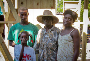 Francois Tifabe and his family in their new shelter. Credits: Cordaid