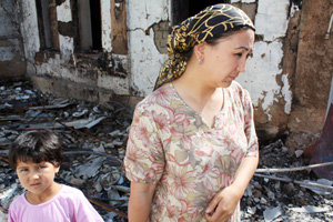 In mid-June 2010, violence broke out in the south of Kyrgyzstan. Many Uzbek homes were burned, people were killed, and thousands of people fled to the border between Kyrgyzstan and Uzbekistan. Some Uzbeks have since returned to their burned-out homes and are living in their yards or porch areas. Others are staying with Uzbek friends in houses away from the city. As of June 23, Catholic Relief Services is assessing needs in Osh and Jalalabad. Credits: Laura Sheahen/Catholic Relief Services