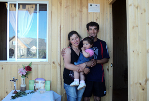 Caritas beneficiaries in front of their new home built by Caritas Credits: Caritas Chile