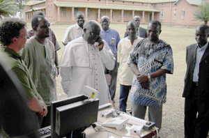 Archbishop Odama of Gulu places the first VoIP call from the Gulu Hub site to the Pabbo IDP camp 70 km away. Credits: BOSCO