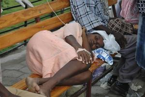 A Haitian resident suffering from cholera waits for medical treatment at a local hospital in the town of Saint Marc. Credit REUTERS/ St-Felix Evens Credits: Credit REUTERS/ St-Felix Evens