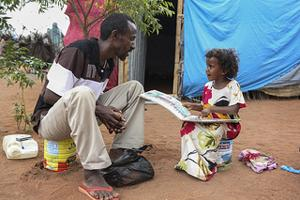 Ahmed and Farhia Hussein study a book on hygiene at the Kambioos Refugee Camp in Dadaab, Kenya. Credits: Sara Fajardo/CRS