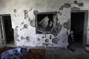 A child walks in a house damaged after heavy shelling by government forces in Sermeen near the northern city of Idlib February 28, 2012. Credits: REUTERS/Zohra Bensemra courtesy of alertnet.org