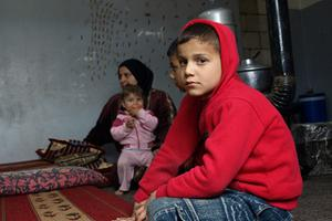 Syrian refugee family being hosted by local Lebanese in Wadi Khaled; northern Lebanon. Credits: Patrick Nicholson/Caritas