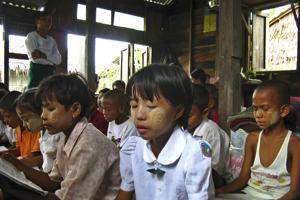 Fifth grade students have reading lessons in their teacher's home at Ma Wun village at Myanmar's Irrawaddy Delta June 10, 2008. Credits: REUTERS/Stringer