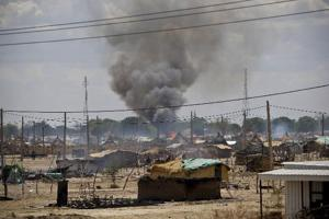 Smoke rise from burnt homes in Abyei town, in this handout photo released by the United Nations Mission in Sudan May 23, 2011. Credits: REUTERS/Stuart Price courtesy of AlertNet.org