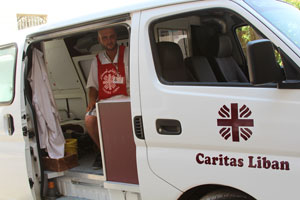 """A Caritas """"mobile clinic"""" travels to Baalbek, Lebanon, to treat Syrian refugee children. Many refugee families are living in unsanitary conditions; children come to the doctor because of diarrhea, coughing, lice, and other problems. Credits: Sheahen/Caritas"""