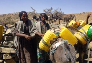 Villagers fetch water from a water point constructed through a Caritas cash for work program. Credits: Caritas Ethiopia