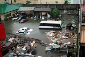 Damaged vehicles submerged in water after flash floods caused by Typhoon Ondoy hit the Philippines Credits: Caritas Manila