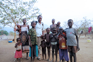 Jane Andanje, the Deputy Coordinator of the Caritas Coordination Unit, with some children who have fled the fighting. Credits: Renee Lambert/CRS