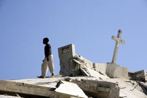 A man standing on the rubble of the Carrefour Cathedral. In the first six months after the earthquake, Caritas has provided food, water, shelter, healthcare, sanitation, counselling and protection at a cost of US$46.8 million (€37.4 million). Credits: Katie Orlinsky/ Caritas 2010