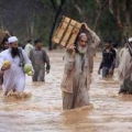 Residents and shopkeepers wade through a flooded street with their belongings after heavy rains in Peshawar July 29, 2010. Almost 200 people have been killed by flashfloods and bad weather in Pakistan in the last week, with the country's northwest and Baluchistan provinces bearing the worst of the storms, officials said on Thursday.