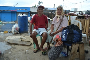 Gerardo Amantillo (74) and Jovita Amantillo (74) survived by clinging onto the roof of a neighbours house. They are photographed at Ormoc pier, where they were queuing for over 30 hours to get a boat off Leyte island. (Photo: Eoghan Rice - Trócaire / Caritas)