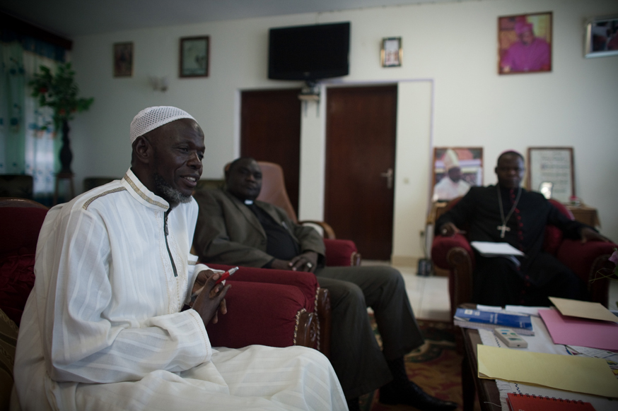 Archbishop of Bangui, Dieudonne Nzapalainga (R), addresses the president of Muslim Community, Imam Omar Kobine Layama (L) and Protestant Reverend Nicolas Gueret Koyama (C) on November 8, 2013 in Bangui. Credit: Matthieu Alexandre/Caritas