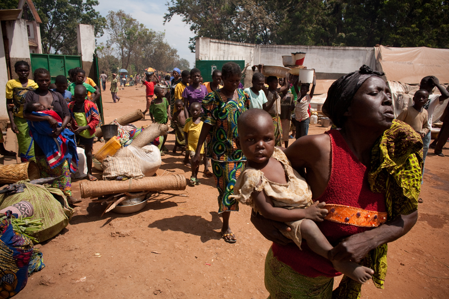 Internally Displaced Persons (IDP's) arrive to take shelter next to the Cathedral on November 10, 2013 in Bossangoa, 380 km north of Bangui. Credit: Matthieu Alexandre