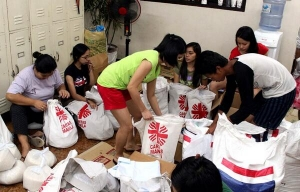 Caritas volunteers preparing aid packages in Manila, Philippines for typhoon survivors Credit: Caritas Manila