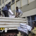ECS Staff loading the materials purchased for the returneesedited