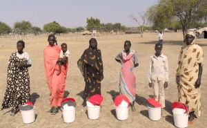 Caritas has been providing basic aid kits to these women displaced by the recent fighting in South Sudan. Credit: Caritas