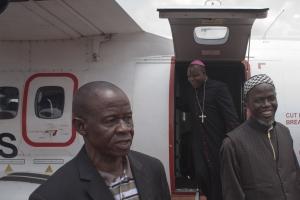 Bangui's Archbishop Dieudonne Nzapalainga (C), flanked by Imam Kobine Layama (R) and Pastor Franco Mbaye-Bondoi. Photo by Matthieu Alexandre for Caritas Internationalis