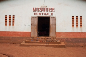 Shoes are pictured at the entry of a mosquee in Bangassou. Photo by Matthieu Alexandre for Caritas Internationalis