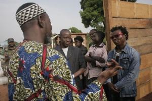 Imam Kobine Layama and Pastor Franco Mbaye-Bondoi talk with Anti-balaka militias. Photo by Matthieu Alexandre/Caritas Internationalis