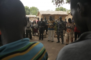 The arcbishop, the pastor and the imam prey for peace with villagers in a remote part of the Central African Republic. Matthieu Alexandre/Caritas Internationalis