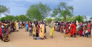 women line up at the Majak Denga Kaya IDP site in Agok, Abyei region, where Caritas distributed plastic sheeting for shelter for 250 families here.