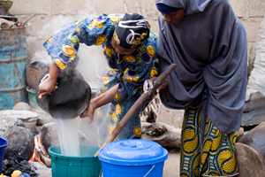 Caritas strives for better economic and social conditions at every migrant's home country, so that emigration will not be the only option left. Here women in Nigeria benefit from a constant supply of water from rainwater catchment tank  provided by CAFOD partner. Credit: CAFOD
