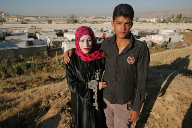 Awad (R), 15, and his new bride Muntaha, 14, poses in a Syrian refugees camp on June 17, 2014 in the Lebanese village of Zahle in the Bekaa valley. They just got married few weeks ago in the camp. Matthieu Alexandre/Caritas