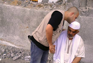 Ameen comforting Ismael follow the deaths of members of his family in bombardments on Gaza. Credit: Caritas Jerusalem