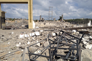 Buildings destroyed in Gaza where people are left with no running water (July 2014). Credit: Caritas Jerusalem