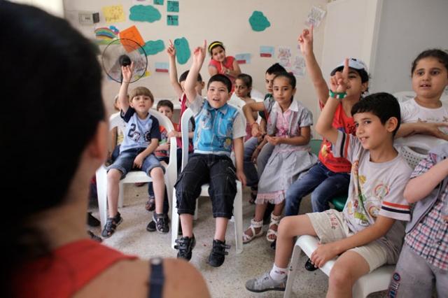 Syrian refugees children attend a class on June 20, 2014 near Caritas Migrant Center at Dekwaneh in Beirut. Credit: Matthieu Alexandre/Caritas