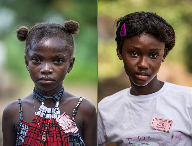 Juliana Ansumana (L), who does not know her age, lost both her parents to Ebola in a village near Potoru in Southeastern Sierra Leone. Katherine Keili(R), 12, lost both of her parents to Ebola in the village of Bumpeh.Sierra Leone. Photo by Tommy Trenchard for Caritas