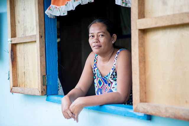 Flora in her new home built by CORDAID, a member of Caritas in the Netherland. Photo by Lukasz Cholewiak/Caritas.