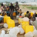 There is a lack of water in Mahama camp in Rwanda, where refugees must wait 8 hours. Credit: Caritas Rwanda.