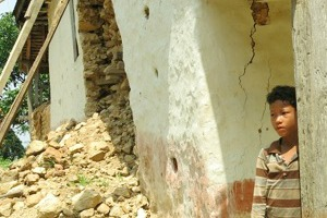 A child outside his home in Sindhuli district. Photo by Prakash Khadka, Caritas Nepal