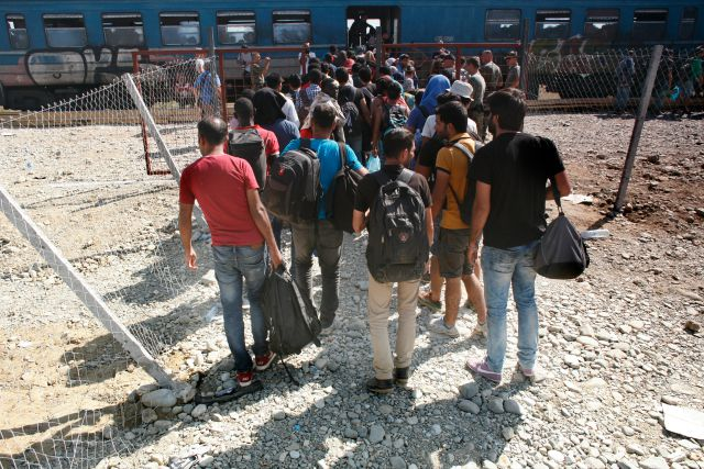 In Gevgelija Station on the Macedonian side of the border with Greece, a train filled with refugees heading to Serbia. Matthieu Alexandre/Caritas Internationalis