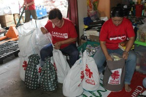 Caritas volunteers in Manila preparing aid packages.