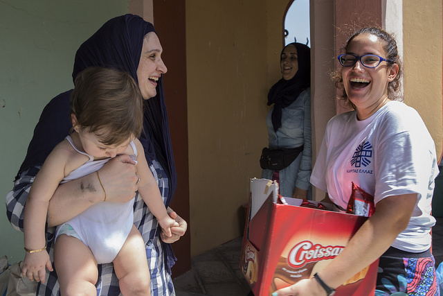Caritas volunteer and a Syrian refugee family on Rhodes.  Credit: Natalia Tsoukala/ Caritas Internationalis