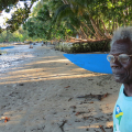 """I hope I die before these islands are covered by the sea."" Eighty-year-old John Sailik was born on the Carteret Islands, a ring of six atolls 50 miles off the coast of Papua New Guinea.  Photo by Nicholson/Caritas"