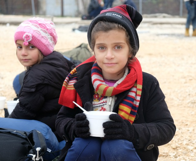 Refugee children receive Caritas soup as they cross from Greece to Macedonia to Serbia on their way north. Credit: Irene Broz/Caritas