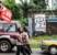 People walk past a Caritas Ebola poster on Savage Street.